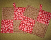 An Adorable set of Quilted Tiny Gingerbread man and Snowflake Pot Holders