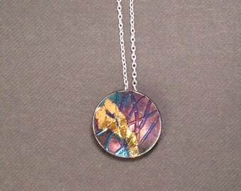 Sterling silver and Keum Boo circle pendant on sterling silver chain.