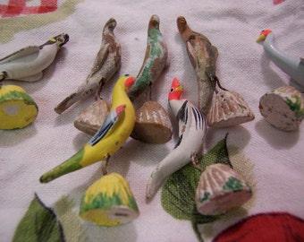tiny clay and plaster birds