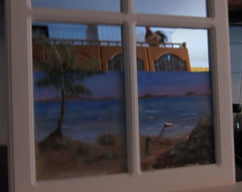 Customer ordered one of a kind mirrored window with a beach scene painted on it.