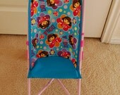 Doll stroller seat made from Dora fabric