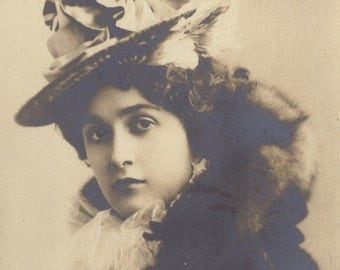 Lina Cavalieri with Lace at Collar and a Tall, Velvet-Ribboned Hat. Circa 1900, by L. Reutlinger
