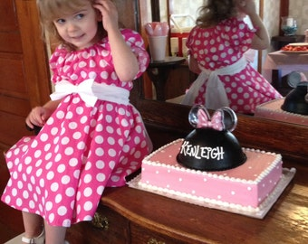 Minnie Mouse pink  polka dot dress(available in sizes 5 and 6) Modeled by Kenleigh on Her birthday.