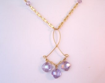 Vintage necklace with wire pendant and purple crystal dangles