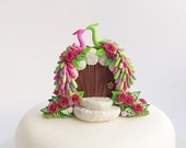 Peacock wedding cake topper in lime green and pink colours handmade from polymer clay