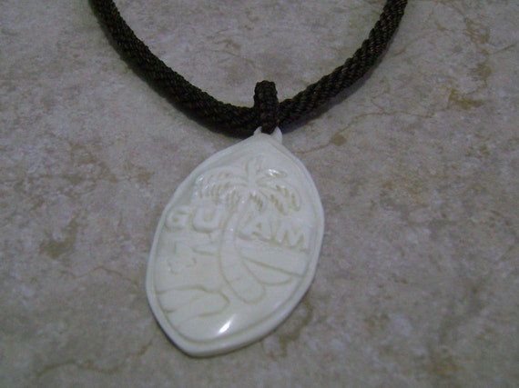 bone carved guam seal engraved charm pendant by