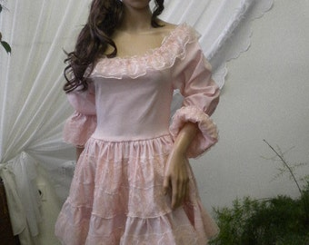 Beautiful and elegant ladies tunic in pink cotton with spandex and lace.