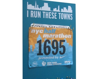 The Race Bibs Rack is your Answer to displaying Race Bibs Proudly