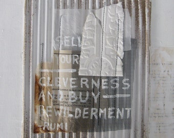 mixed media collage with rumi quote.  white painting collage.  bewilderment.