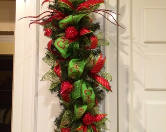 Merry christmas swag or centerpiece. Can be used for mantel,door or mantel.