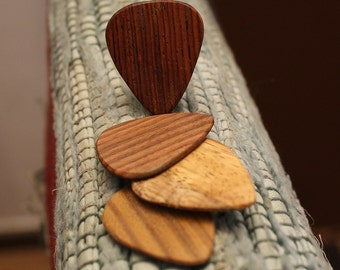 4 wood guitar picks. Mexican Granadillo, Zebrawood, mango & Lignum Vitae   wooden guitar picks