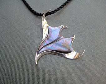 "This ""Seawing"" Manta Ray pendant depicts the beauty and flow of these incredible creatures!"