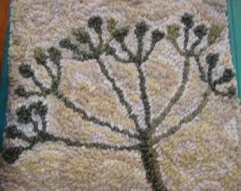 A Flower in Winter hooked Rug