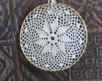 6 inch delicate eye-catching crochet window or wall hanging with a small crystal
