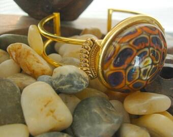 Gold tone bracelet adjustable cuff; bead blue orange