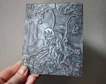 Adam and Eve in the Garden of Eden. Humorous Salvaged Vintage Metal Letterpress Stamp.