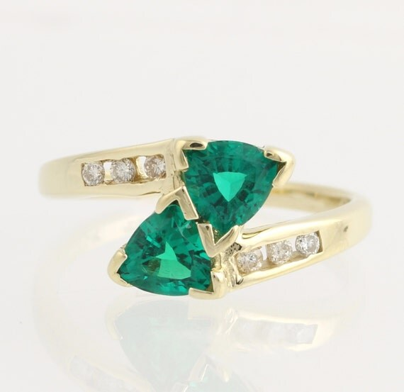 synthetic emerald bypass ring 14k yellow gold may