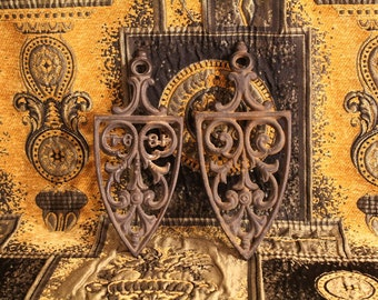 two cast iron trivets