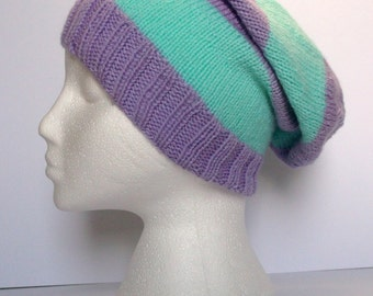 Lilac and light green striped hand knitted super slouchy beanie hat. Adult or teenager. Unisex
