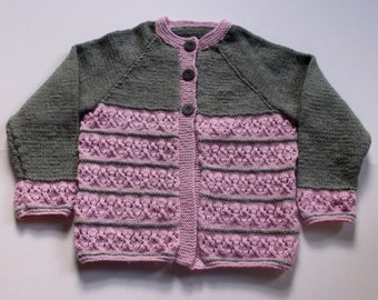 Hand knitted toddler girl's cardigan. Grey and pink 2 tone cardigan. To fit 26 inch chest.