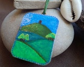 Avalons Apples stylized Glastonbury Tor painted onto wooden pendant