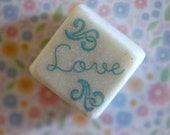 Love...blue flourishes swirls small square stone magnet 3/4 x 3/4 cute word..gift favors fridge