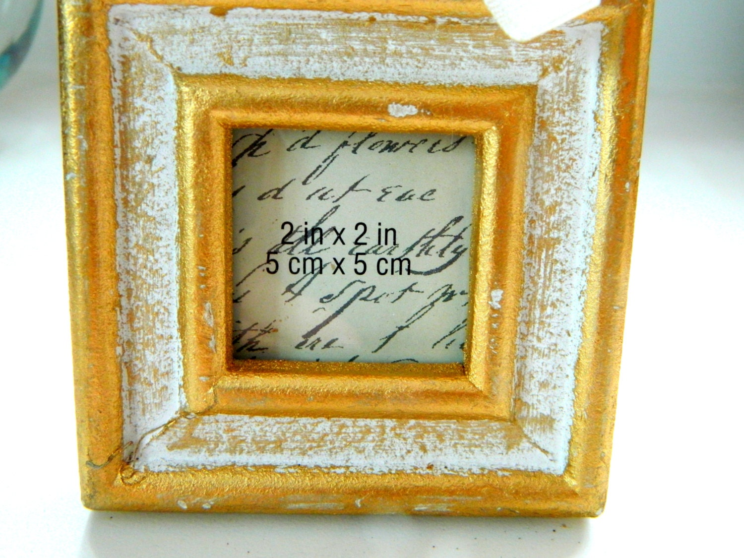 Gold Antiqued Frames ribbon hanger Size is 2x2 inches