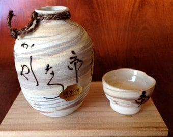 Sake for one? Hand thrown Ceramic Sake container and cup