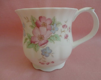 """VINTAGE Mug 1980s Bone China - White bulb shaped featuring a cluster of pink and blue flowers with light green leaves, """"Current Inc."""" Taiwan"""