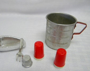 Toy tin and plastic kitchen tools in red and white retro style vintage toys