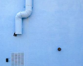 Blue pipe on blue wall. Brooklyn, NY