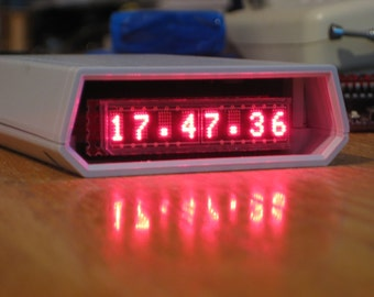 Miniature extremely accurate LED alarm clock
