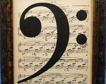 Bass Clef Music Note Art Print on Antique Music Book Page