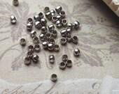 2 mm Platinum Plated Round Crimp Beads. (.mmsg).
