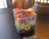 Wind up metal pecking chicken toy