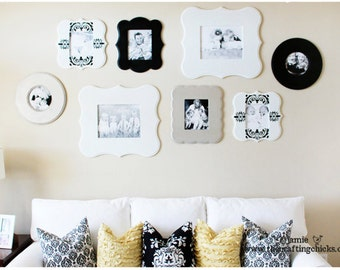 Gallery wall of whimsical unpainted frames - Jamie's Wall Go Grand