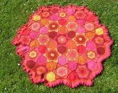 Red, orange, yellow and pink alpaca baby blanket.