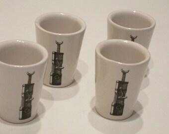 4 Ceramic Shot Glasses Made in Western Germany. Unique Shotglass set