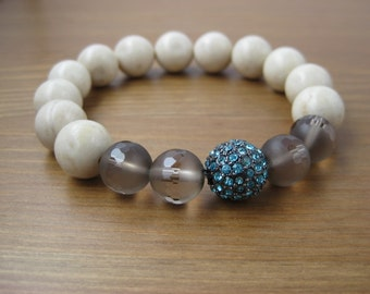 Riverstone and faceted smoky quartz gemstone stack bracelet with turquoise blue crystal pave bead
