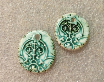 Rustic chic ceramic blue charms look ancient yet modern...