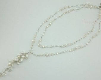 White freshwater pearl and quartz on silk thread necklace.