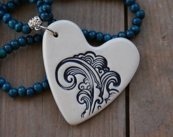 Dark Blue Wave ceramic heart shaped necklace with blue wooden beads