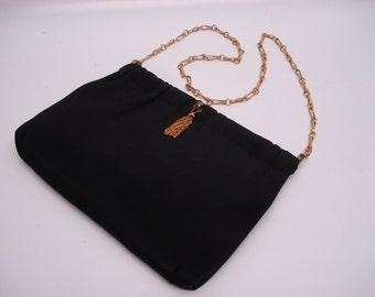 Stunning black evening bag with gold hardware