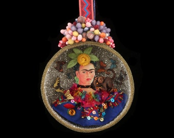 Hanging diorama of Frida Kahlo, consisting of a papier-mache box with a clear pane in front
