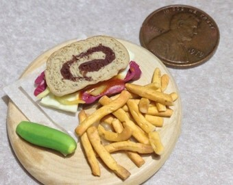 Miniature reuben sandwich with fries and pickle!