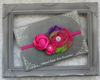 Fushia, purple, and green trio on adjustable elastic headband