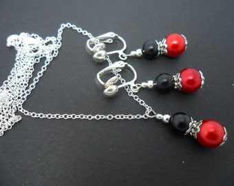 A hand made red and black glass pearl  necklace and clip on earring set.