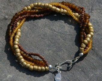 Shades of Autumn glass beaded bracelet with sterling silver clasp