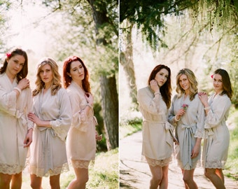 Veil of Mist. 6 knee length robes in faux crepe de chine silk trimmed with lace. Bridal robes and bridesmaids robes in neutral tones.