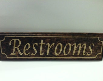 """Small Engraved Wooden """"Restrooms"""" Sign 5 1/2 x 15"""